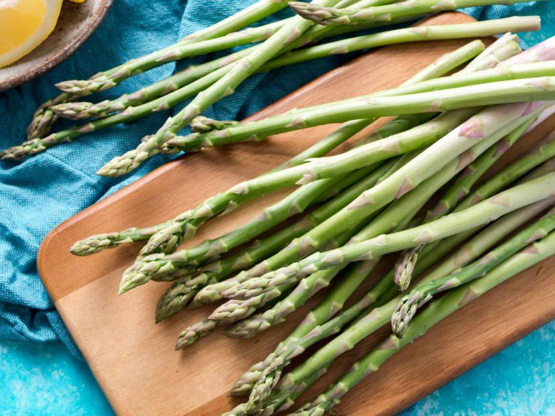 Asparagus on table with lemons
