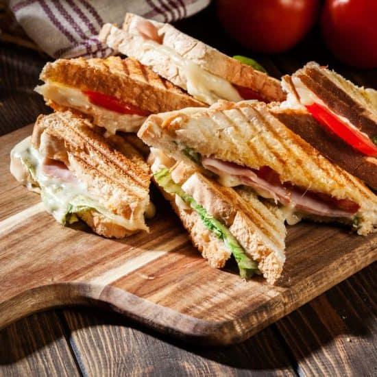 Panini sandwiches on cutting board