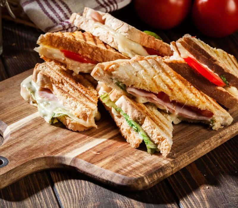 Panini sandwiches on cutting board