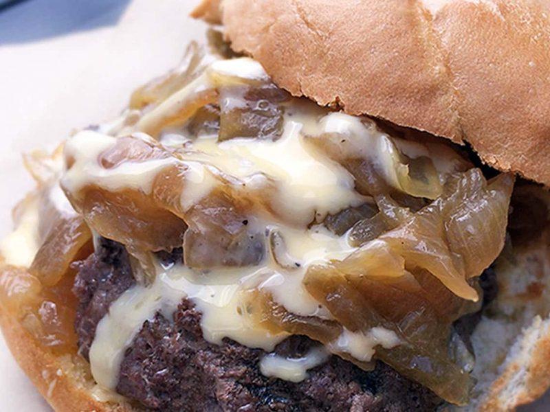 Cheddar melt burger with teriyaki onions