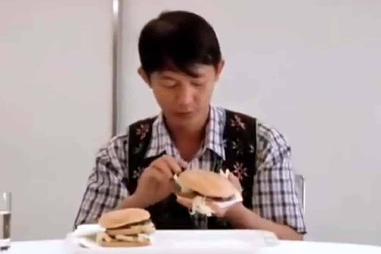 People eat burgers for the first time